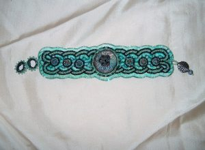 Br Button Celtic Aqua